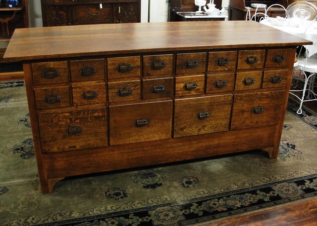 Early 1900s Quarter Sawn Oak Pharmacy Apothecary Cabinet with Drawers on Both Sides