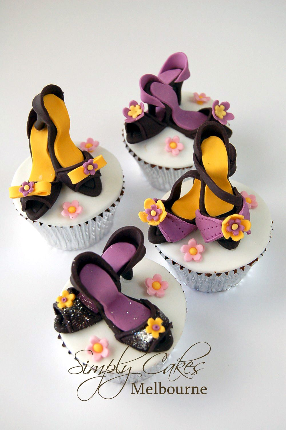 "I just searched ""shoe cupcake images"" and am overwhelmed by the creativity.  Maybe if I start now I can have some of these ready by my birthday--5 months away!"