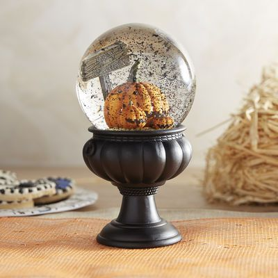 Pumpkin patch hand-painted snow globe. Perfect accent for any spirited Halloween display.