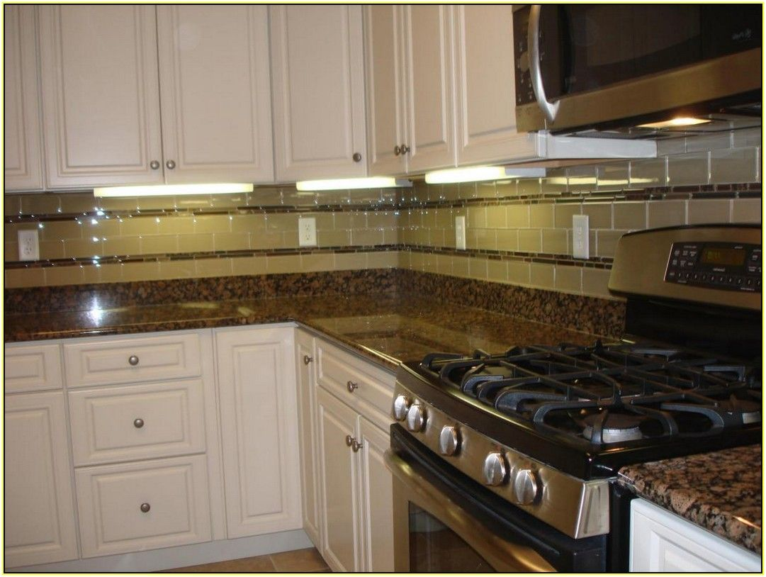 Baltic Brown Granite Countertops With White Cabinets Backsplash