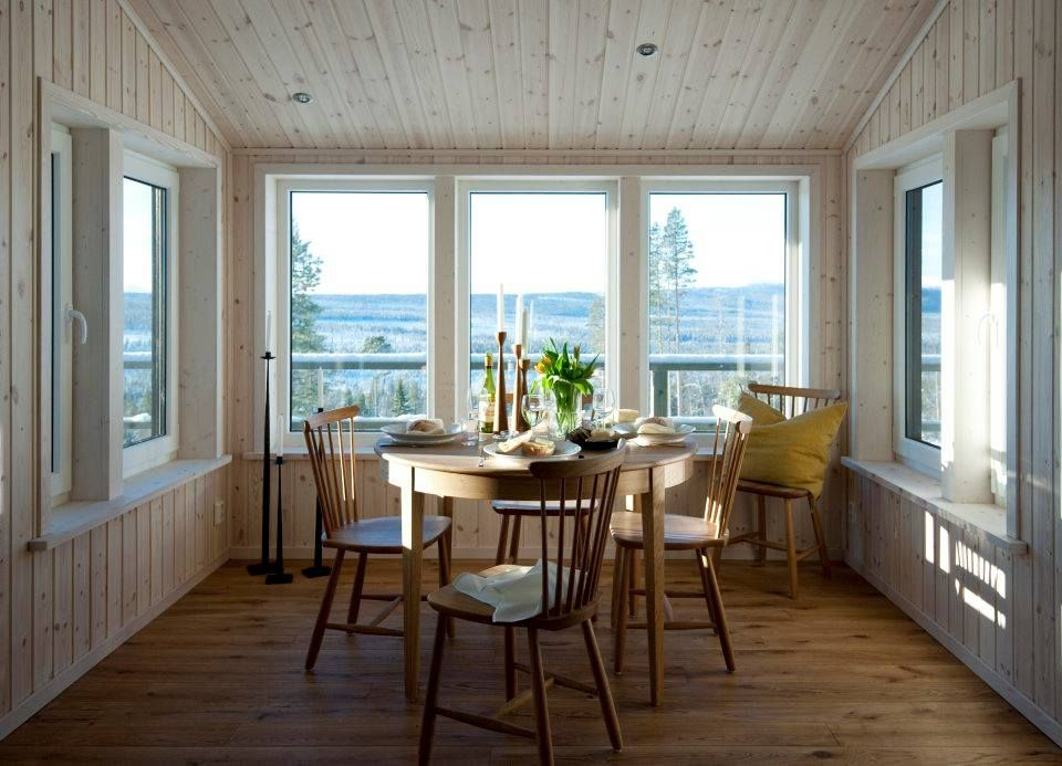 Swedish mountain lodge - table set with Rolf™ candleholders in raw oak by freemover.se