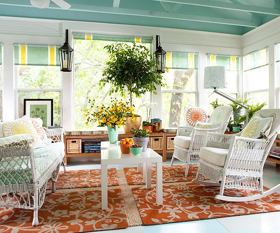 Love this room with its wicker and awnings surrounding it... Great room or porch!