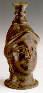 Parthian Furniture Support Depicting the Head of M Origin: Northern Syria Circa: 200 AD to 400 AD Dimensions: 5.625 (14.3cm) high x 2.5 (6.4cm) wide Catalogue: V4 Collection: Near Eastern Medium: Bronze