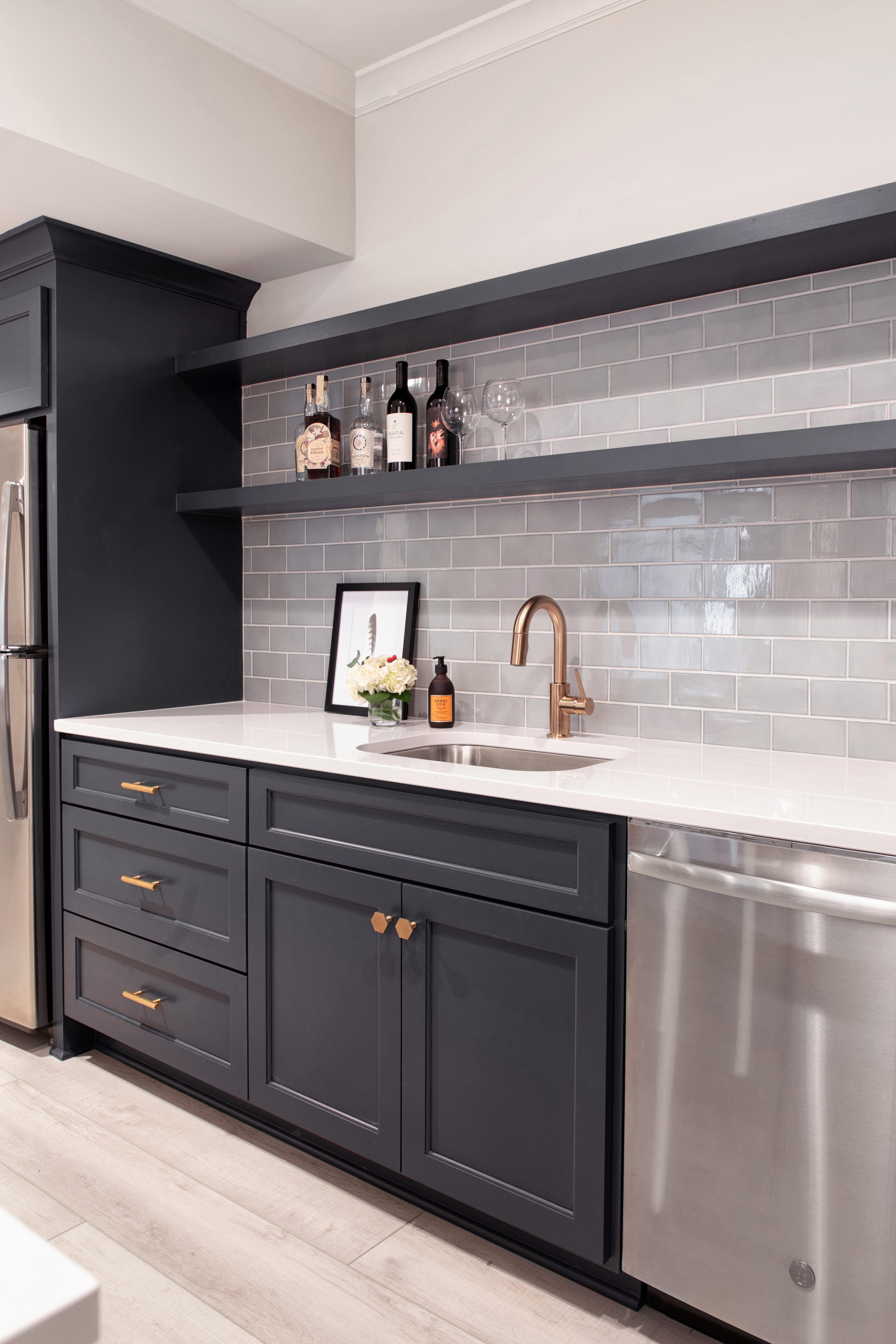 Basement Kitchen Blue Cabinets White Tile Backsplash Some Houses Have Basements And Sometimes It Is In 2020 Basement Kitchen Basement Makeover Basement Kitchenette