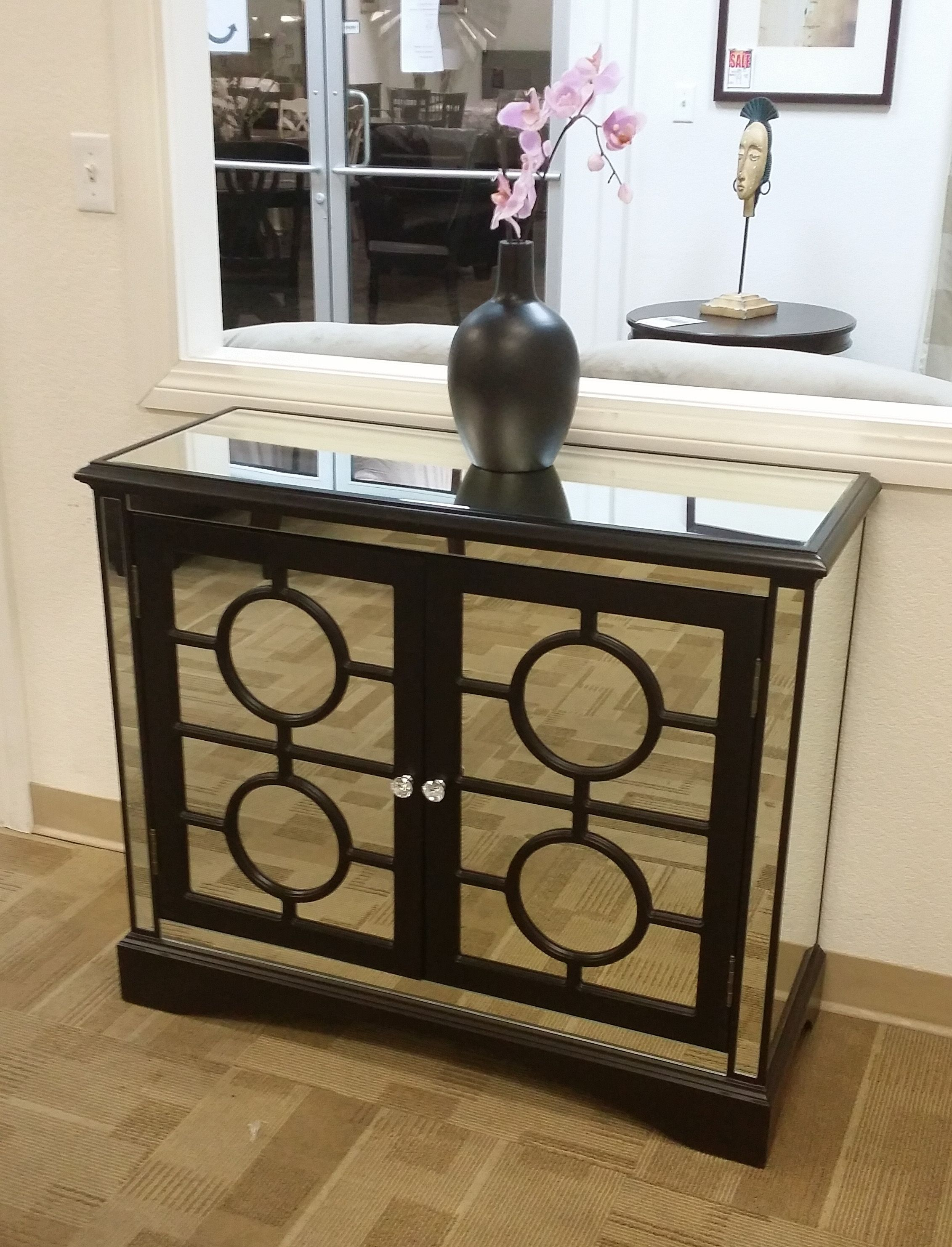 Mirrored cabinets make a impact.