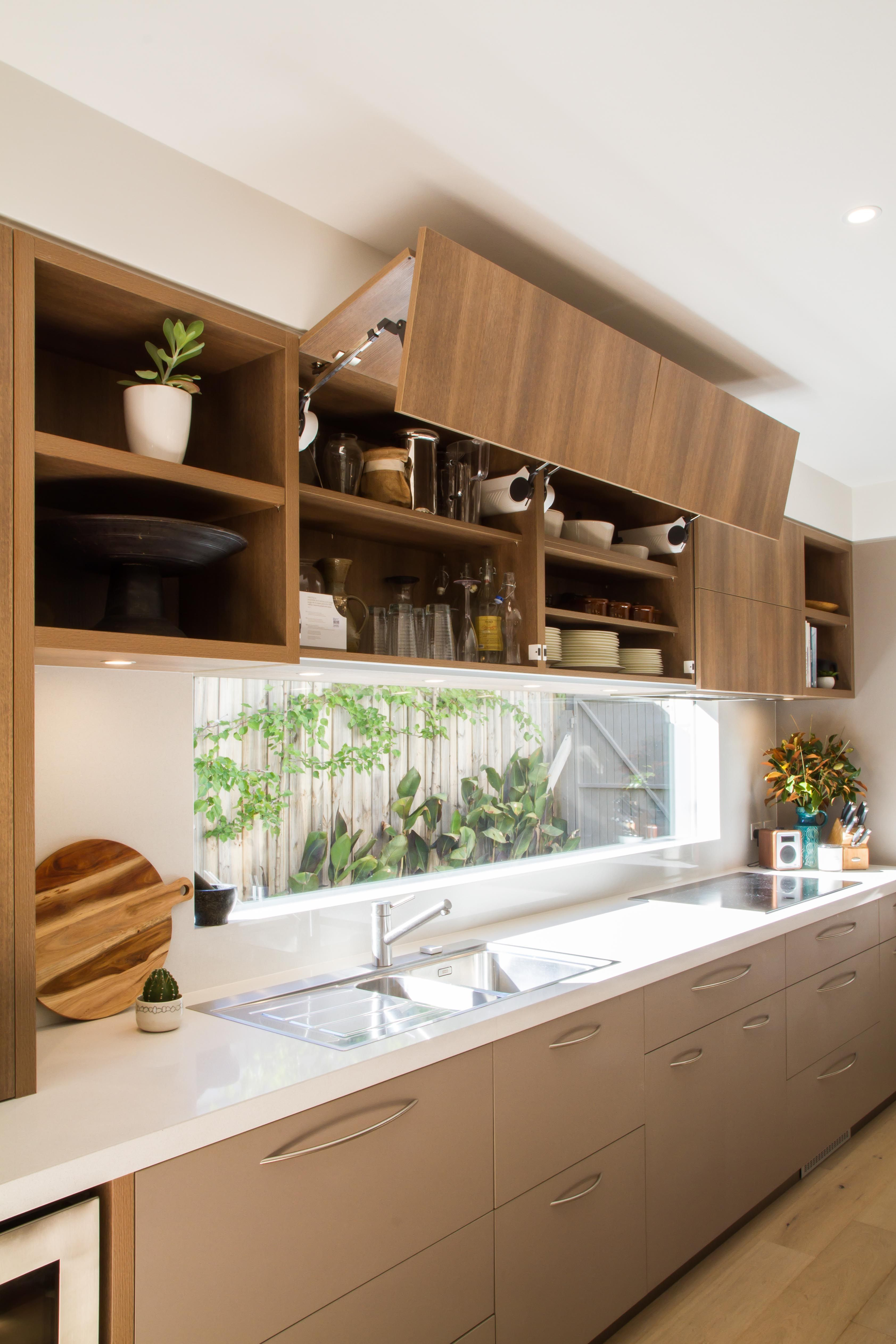 Large, modern, contemporary kitchen in warm tones with a ...