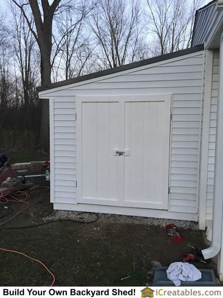 Front elevation home built shed doors installed on lean to for Lean to addition to garage