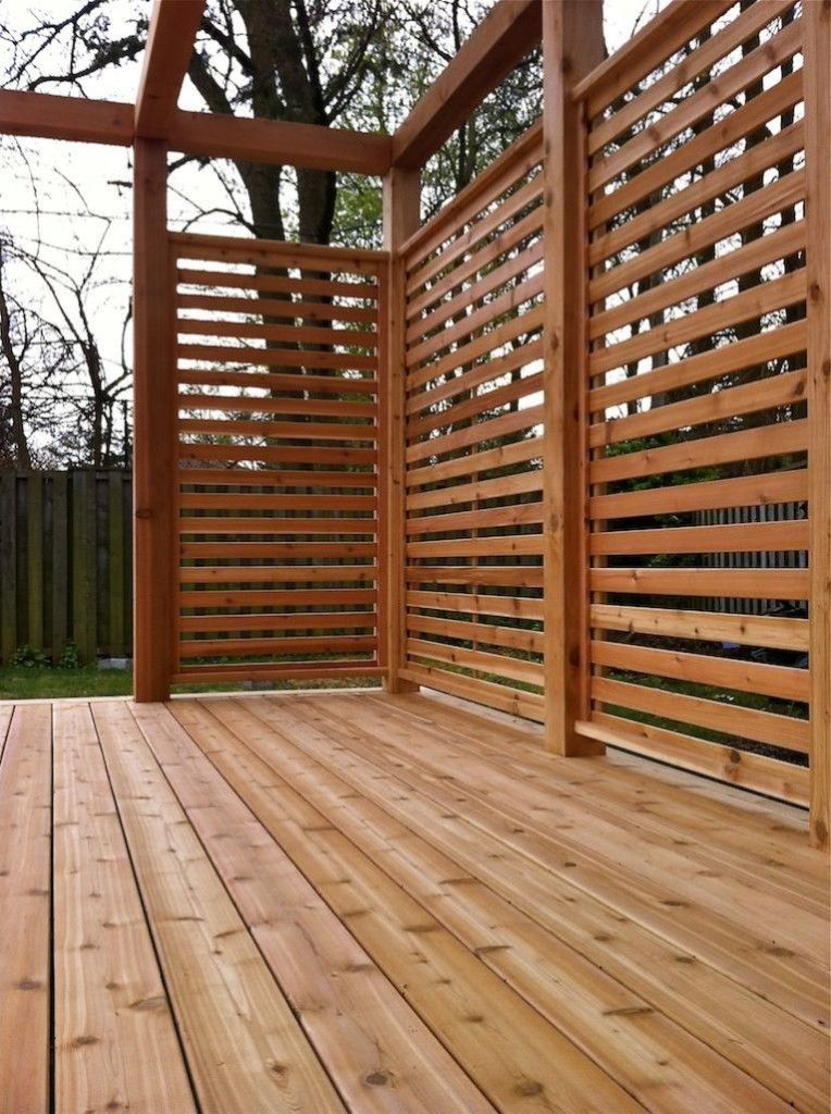 Cedar stained horizontal privacy screen outdoors for Wood patio privacy screens