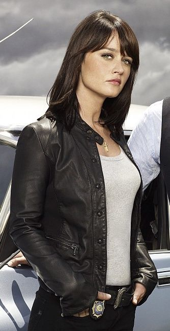 """Character Theresa Lisbon (I can't remember her real name right now) from """"The Mentalist"""". My favorite character (besides Simon Baker as Patrick Jane-TOO ADORABLE). One of the few fictional people I would actually swap places with for a day if I had the chance. She reminds me a lot of myself, but cooler."""