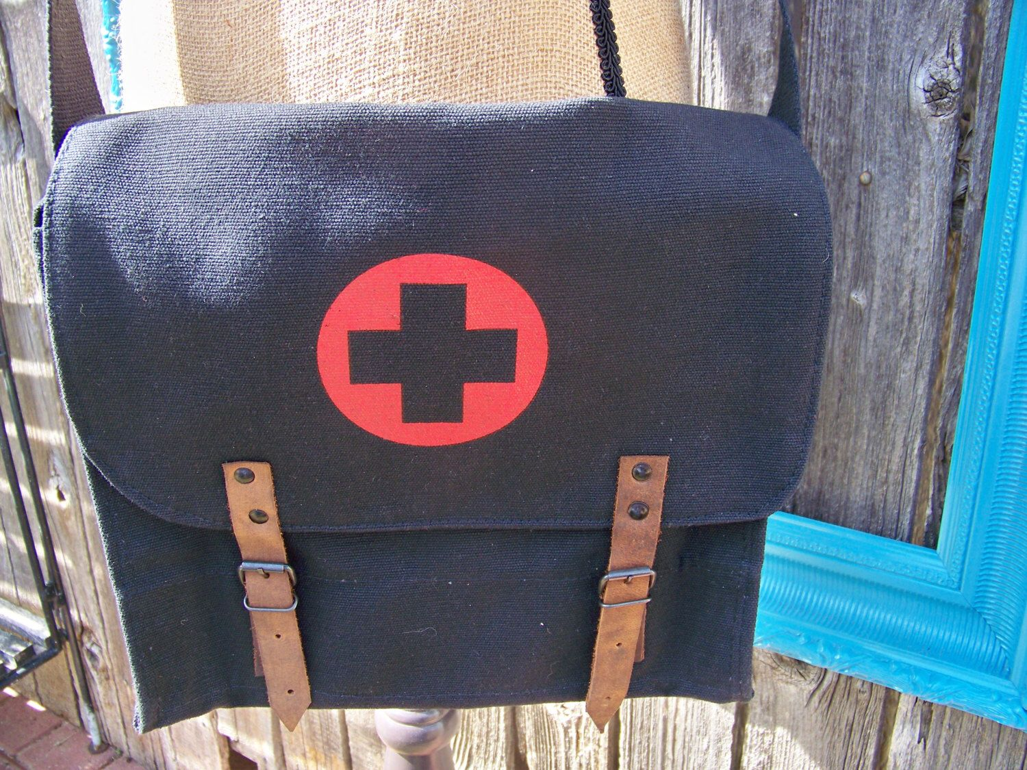A personal favorite from my Etsy shop https://www.etsy.com/listing/163077504/black-vintage-military-canvas-medic