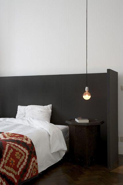 black minimal headboard plus Moroccan bedside table and