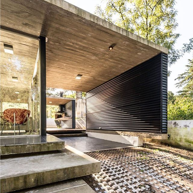 supported on reinforced concrete bases and metal columns ...