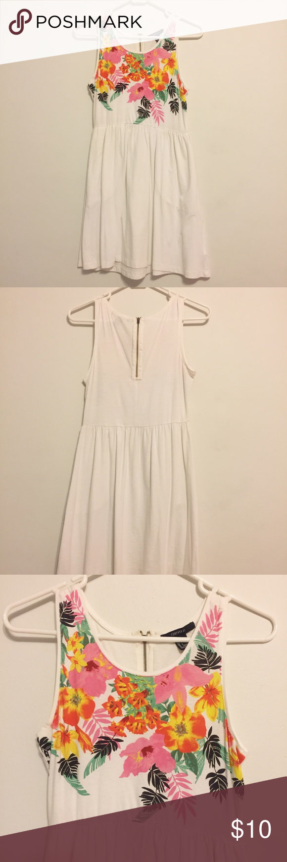 White Floral Dress White Floral Dress - Floral design on top half - Gold zipper in back - True to size (S) - Has pockets   Condition: worn once, good as new  Price is not firm, feel free to make an offer. NO TRADES. Forever 21 Dresses