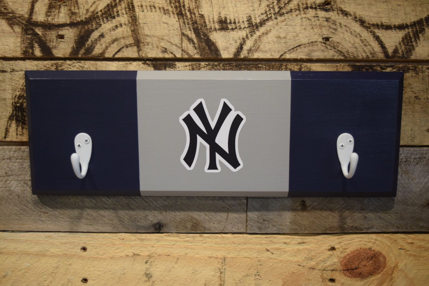 A personal favorite from my Etsy shop https://www.etsy.com/listing/482230821/new-york-yankees-2-hook-hat-coat-rack