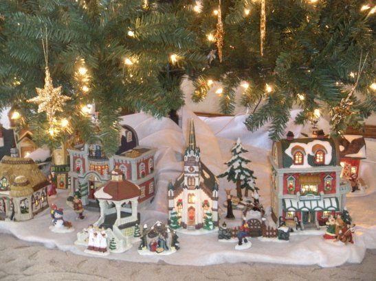 eee the under the tree christmas village my most prized holiday memory i appreciate the effort put forth in this picture but it doesnt hold a candel - Christmas Tree Village