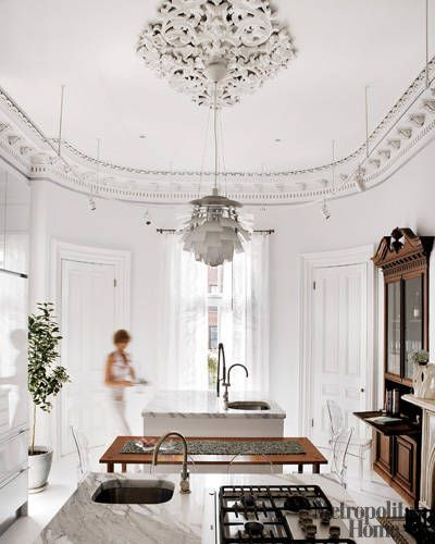 The Poul Henningsen Artichoke Suspension Light looks its best in an old and new setting - image via ELLE Decor