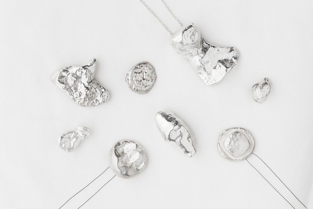 """In bits and pieces"" by Janne K Hansen. 2013. Brooches and pendants, fine silver, silver 925, 18k,14k gold, silk string."