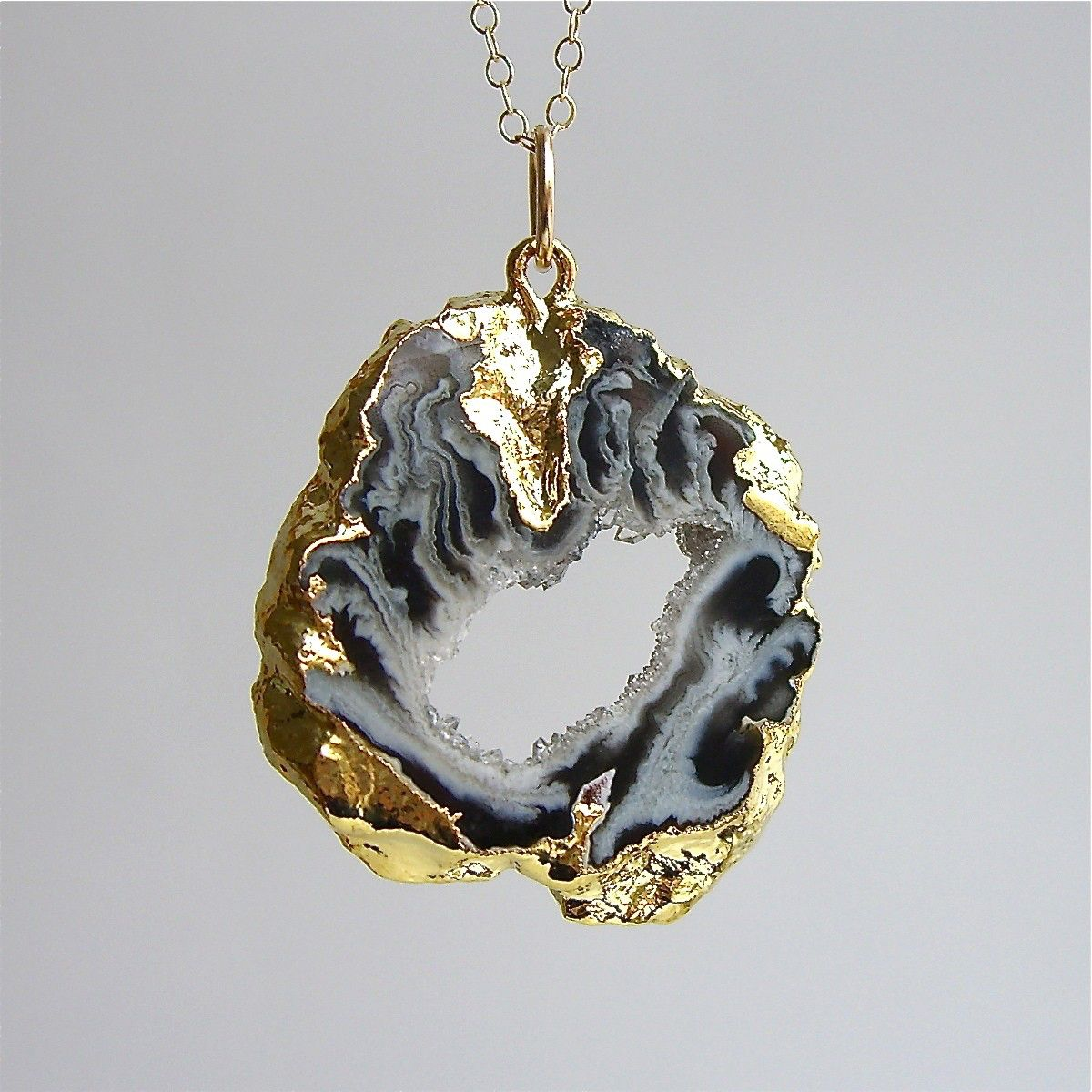 Gold-fill Long Gold Plated Geode Slice Necklace by solisjewelry on Etsy https://www.etsy.com/listing/61248171/gold-fill-long-gold-plated-geode-slice