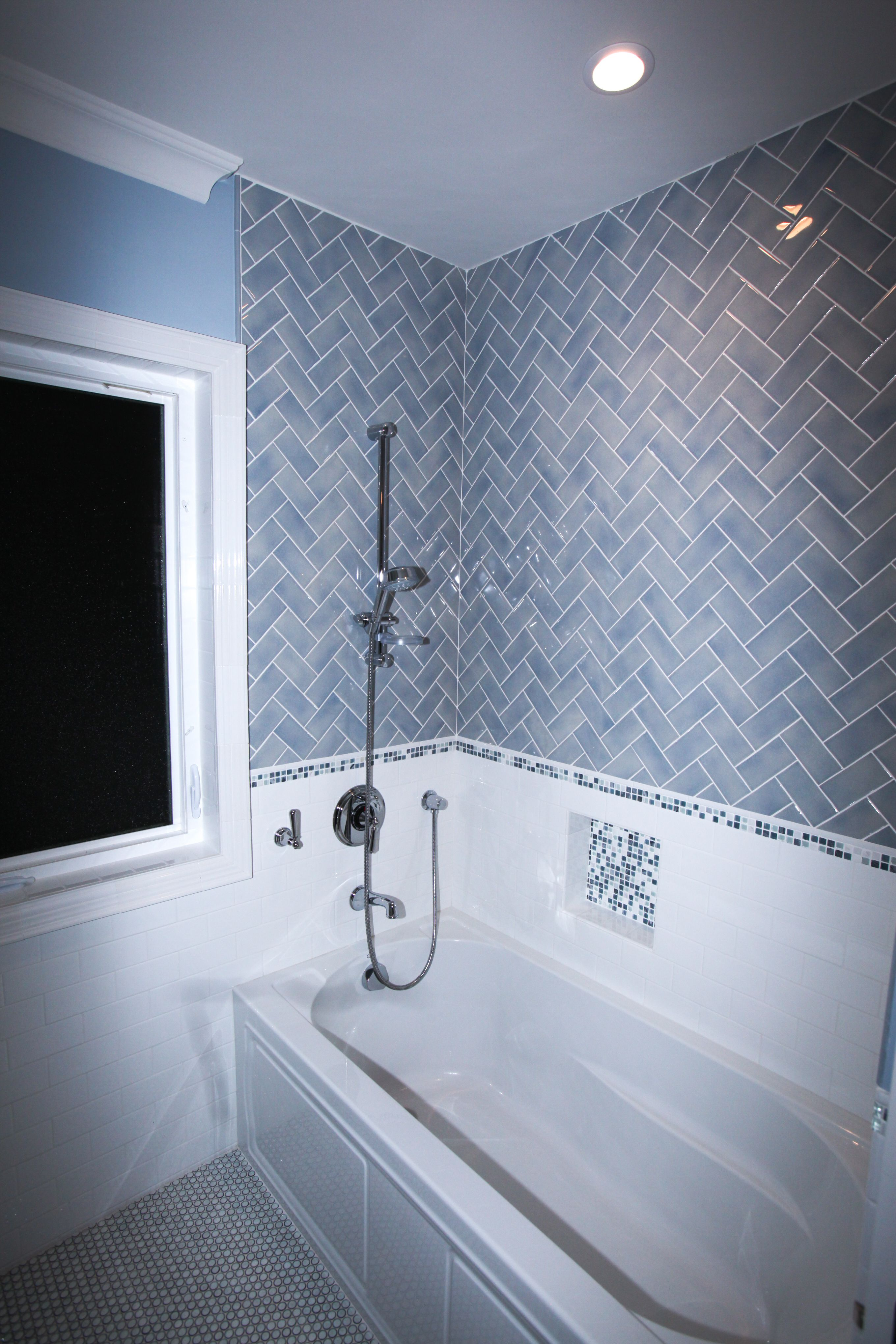 White Subway Wainscoting With Blue Tile In A Herringbone Pattern For The Upper Portion Of The Tu Bathroom Paint Colors Bathroom Paint Design Blue Bathroom Tile