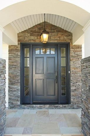 Traditional Front Door With Stacked Stone Wall Transom Window