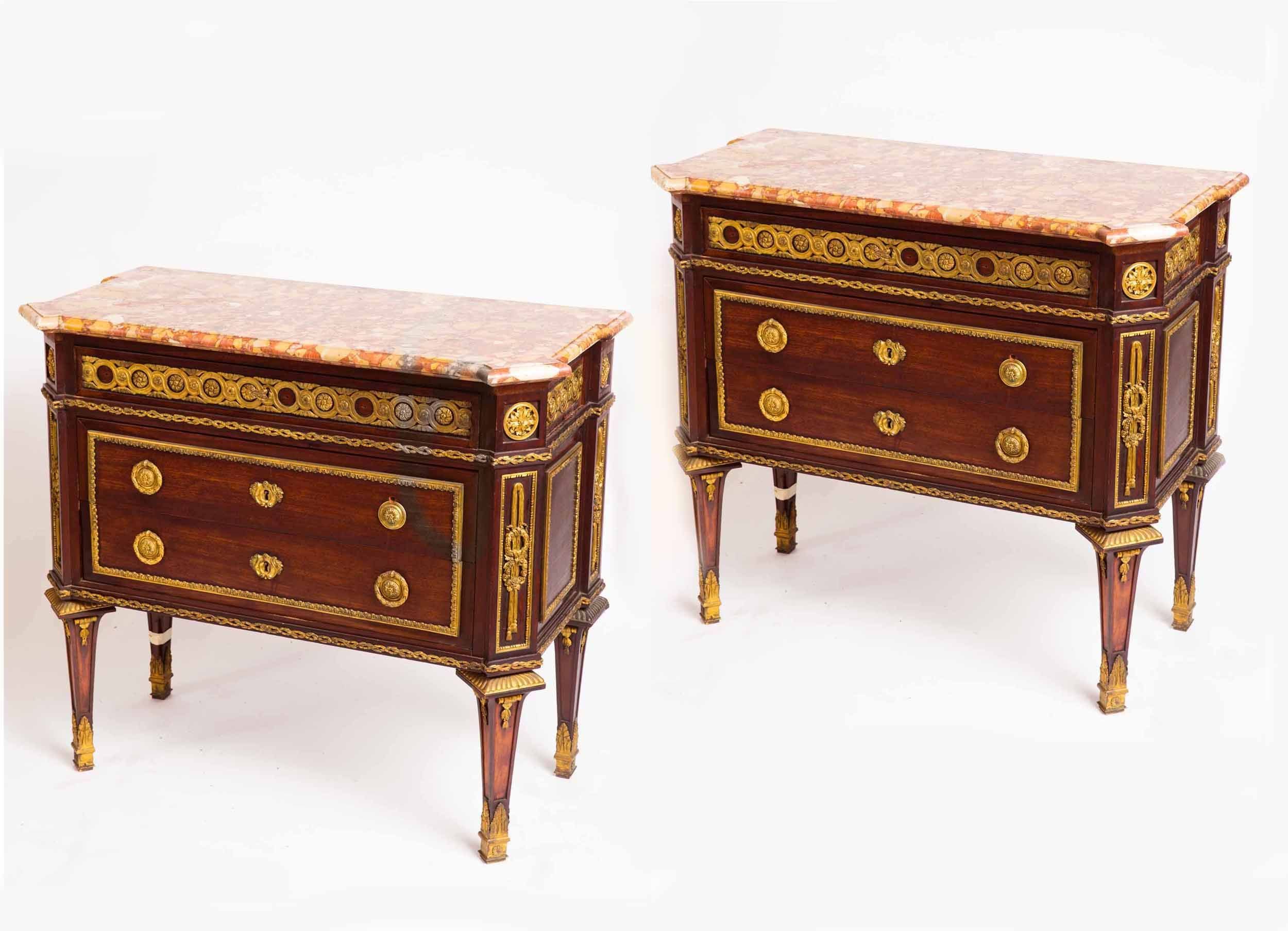 Team with contemporary artwork and lamps- Pair of 19th century French Louis XVI commodes.