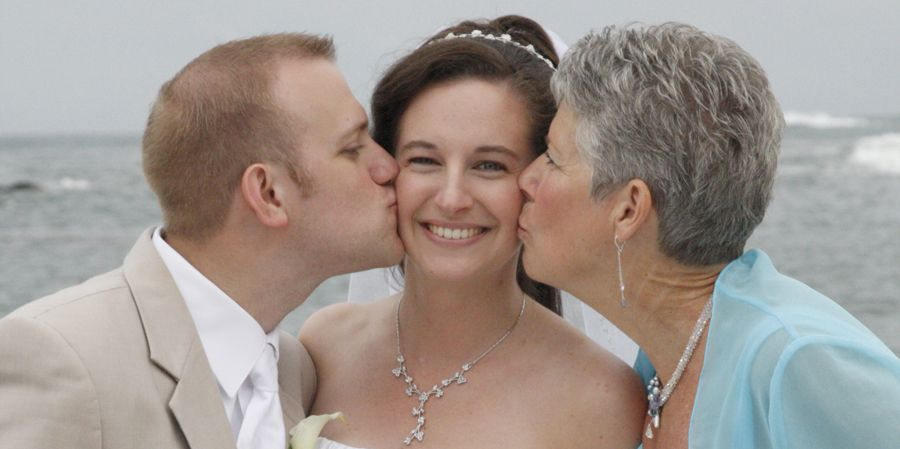 Beach Wedding Kiss With The Mother Of Bride And Groom At