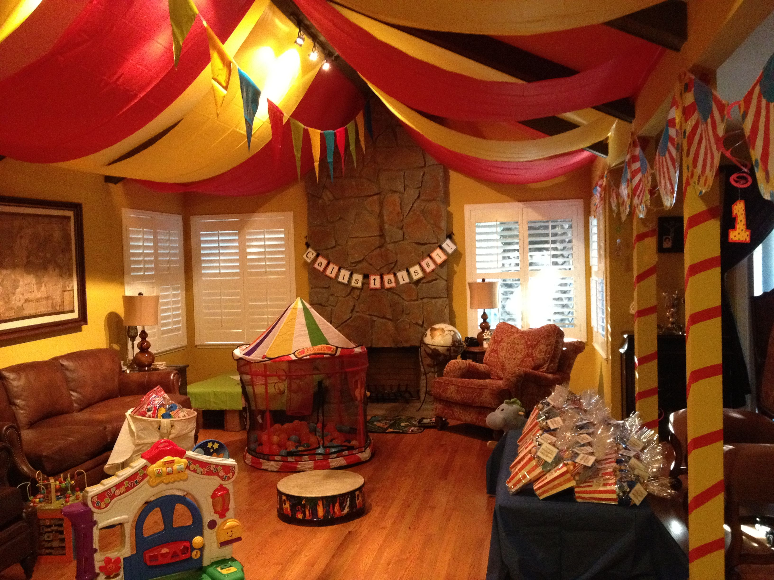 1st Birthday Circus We Turned Our Living Room Into A Circus Tent By Using Red And Yellow Tablecloths Yellow Tablecloth Design Interior Design