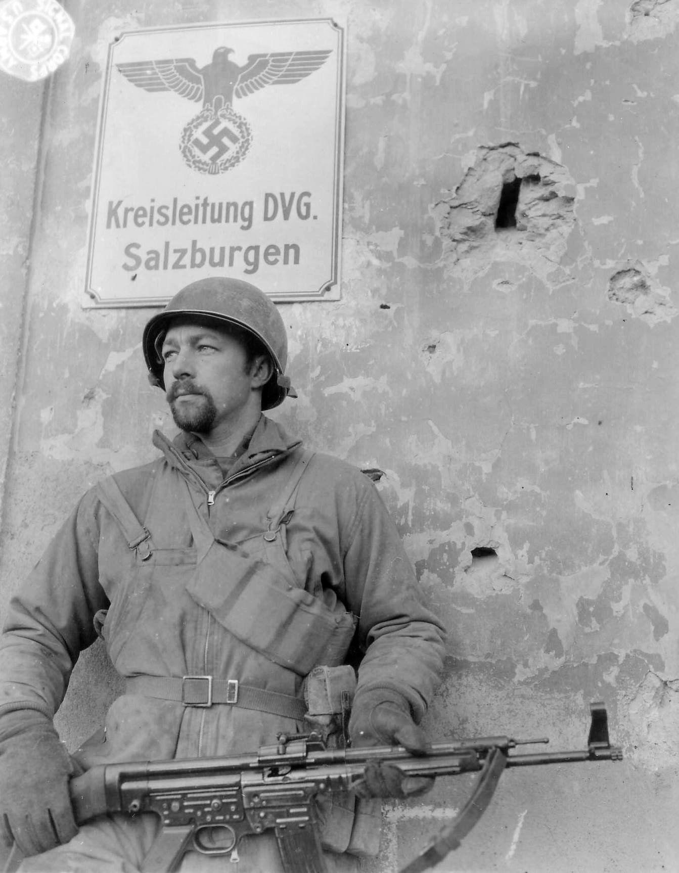 An American soldier with a captured German STG44. This was the 1st ever full-on assault rifle. It had a very high rate of fire & was extremely durable...