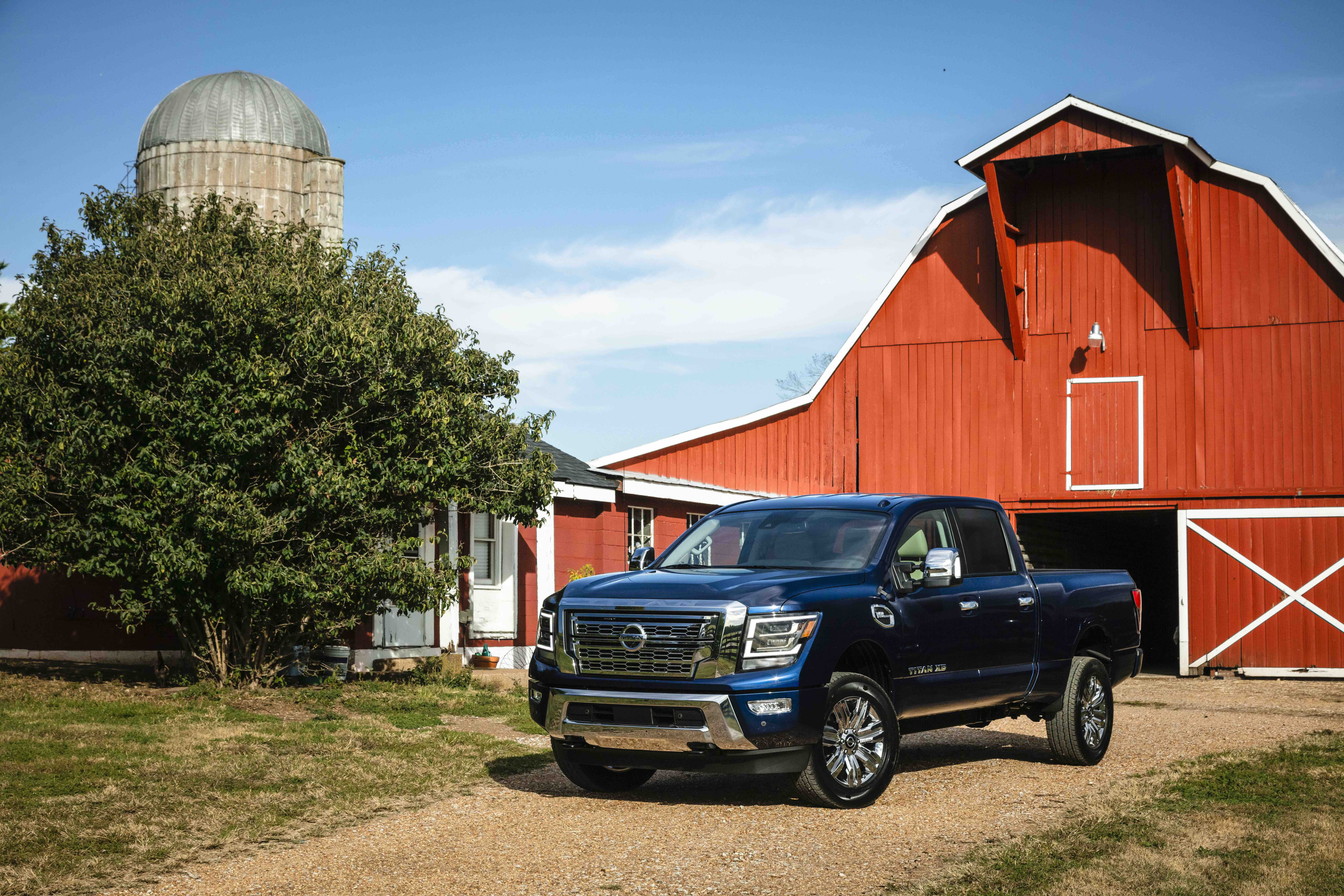 The Titan Xd Is Three Inches Taller Than The Regular Titan 14 6 Inches Longer Overall And Rides On A 11 8 Inch Lon Nissan Titan Nissan Titan Xd Nissan Trucks