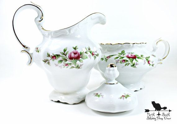 This is a beautiful cream and sugar set in the highly collectible Moss Rose pattern by Johann Haviland with the much sought after Bavarian
