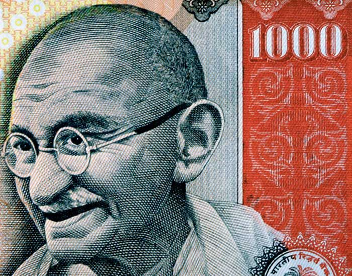 indian rupee 1000 with picture of mahatma gandhi