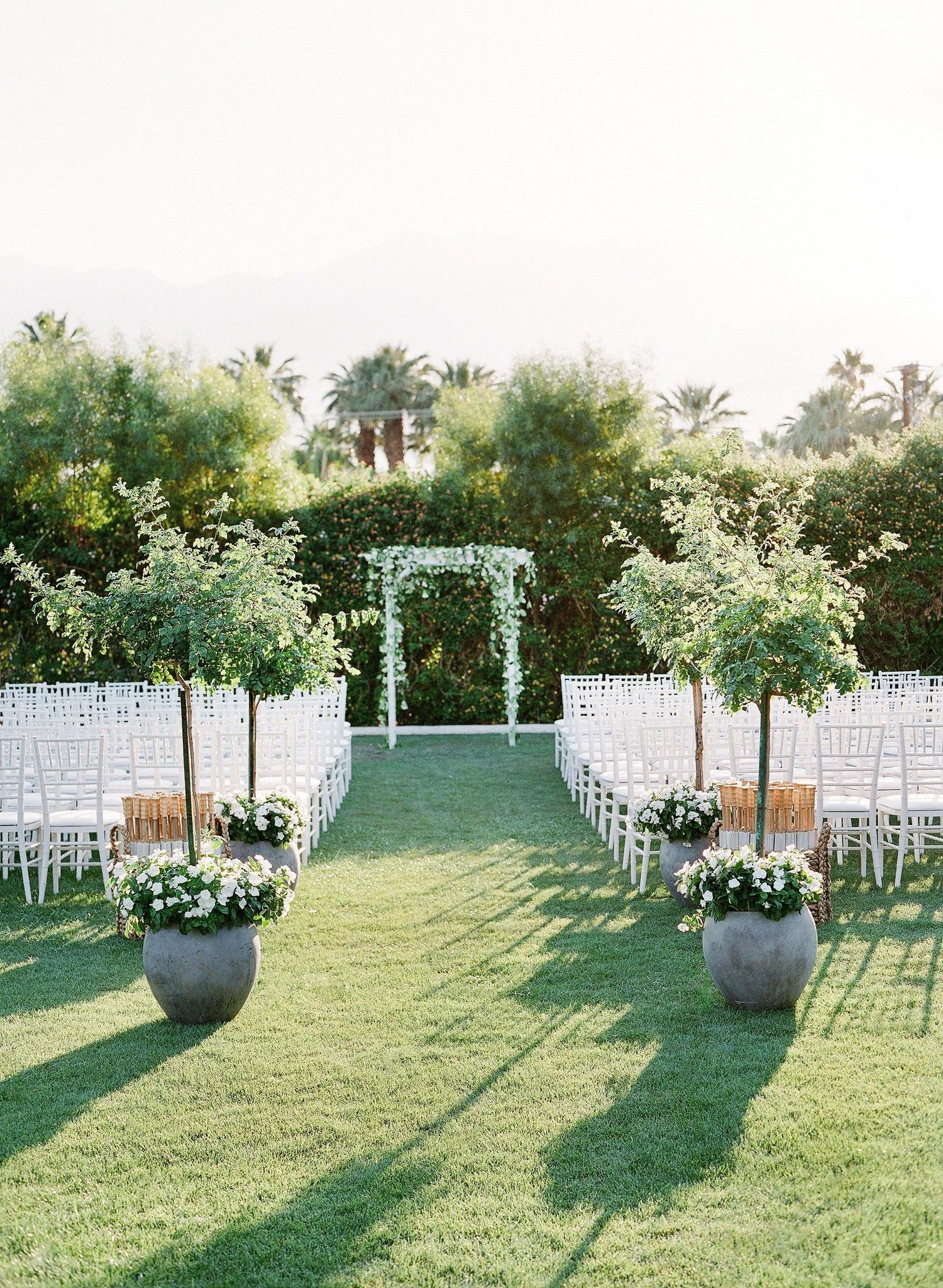 This Casual Outdoor Wedding Ceremony Included A Simple White Wedding Arbor That Matched Th Outdoor Wedding Arbors Outdoor Wedding Decorations Wedding Ceremony