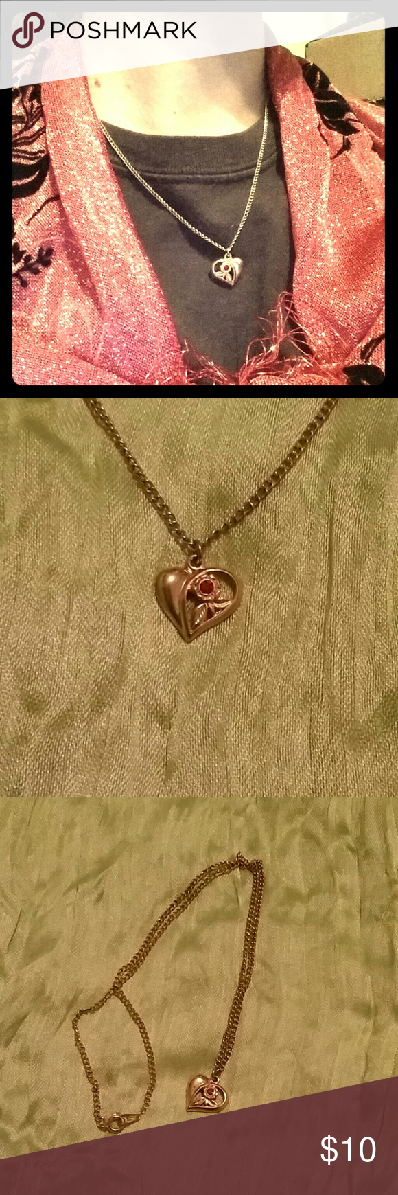 Gold coloured heart necklace with red stone 17 inch chain with circular clasp. Jewelry Necklaces