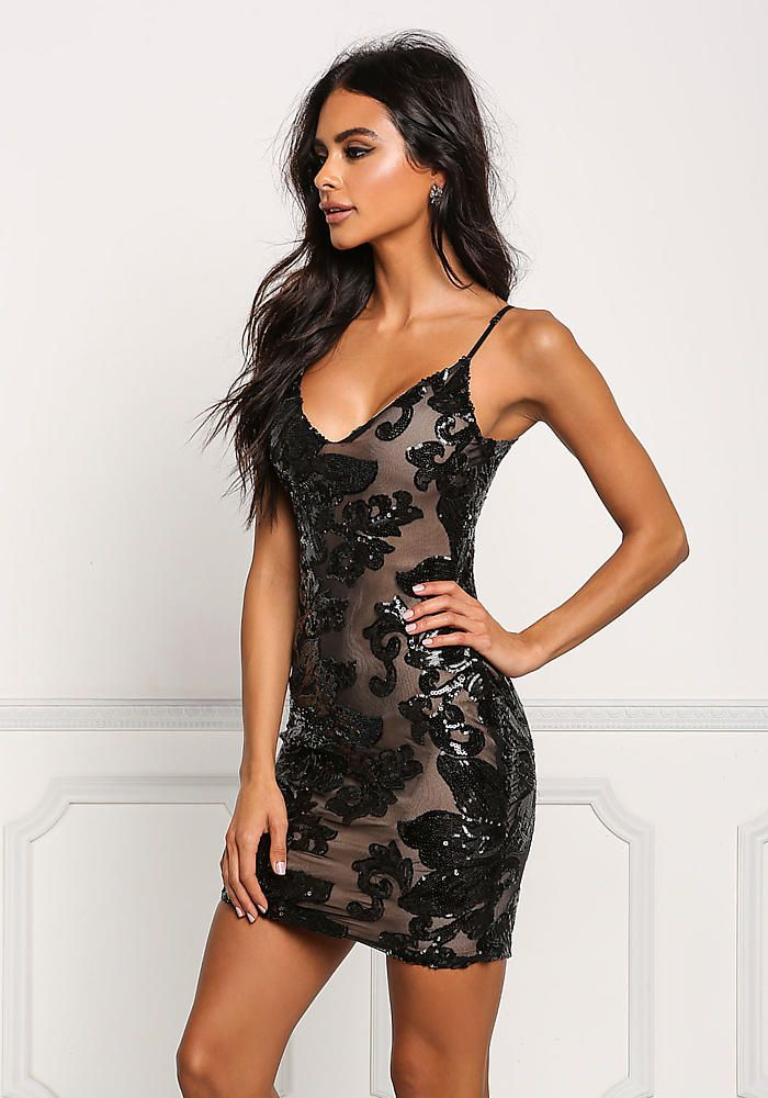 A flawless bodycon dress in a mesh bodice covered in sequin with a floral  pattern all throughout. Features a low back wit thin cross straps and a plunge  V ... eb271c4d4