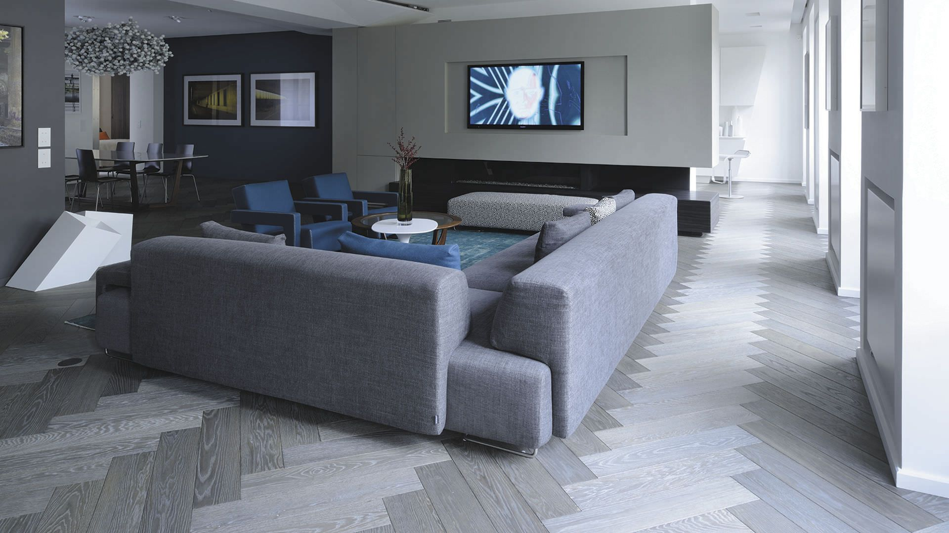 Storm inspired grey and blue living room. Herringbone