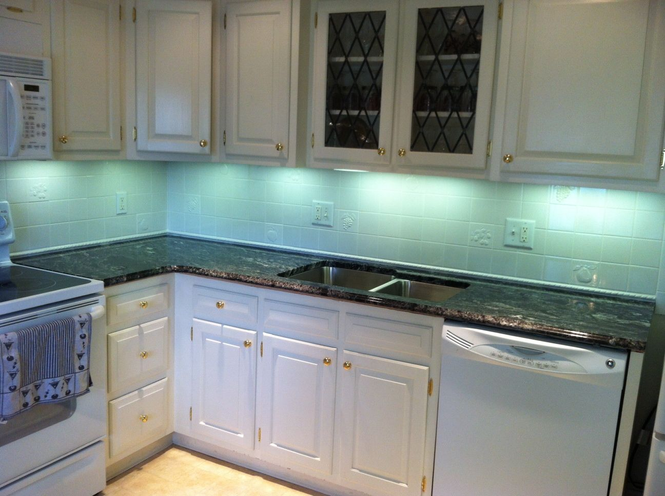 Silver Waves Granite on white cabinets | Our Beautiful Work by Down ...