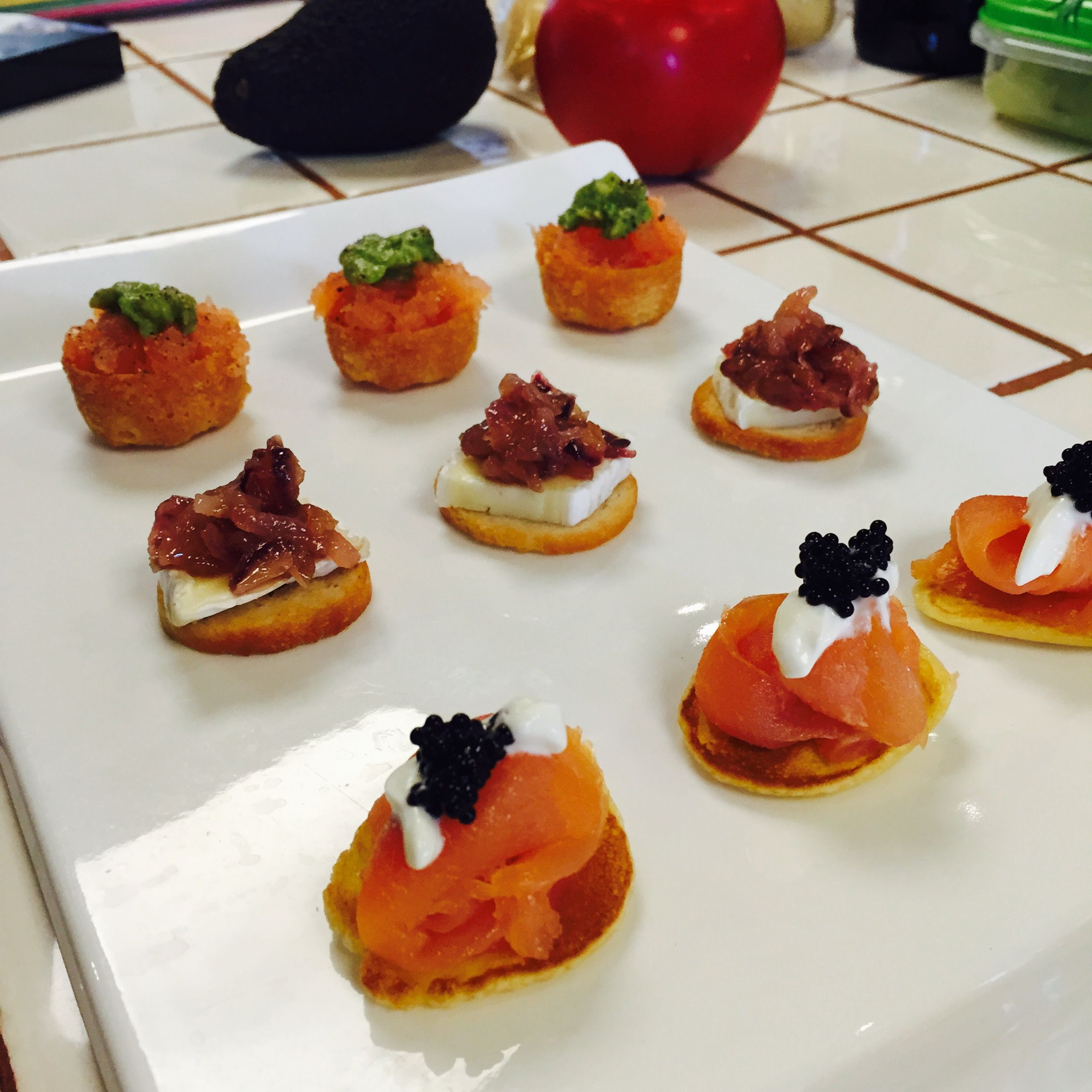 Blinis with Smoked Salmon, Creme Fraiche & Caviar, Camembert Crostini with Sweet Onions (V) Salmon Tartar with Avocado #Catering #Marbella #Spain #Sotogrande #Gibraltar