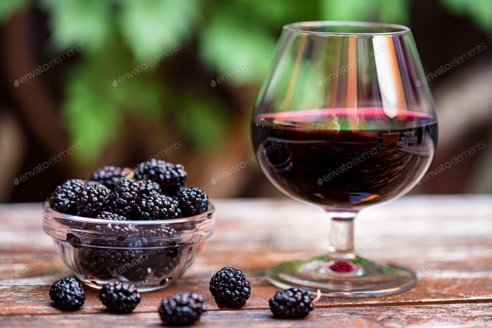 Fresh Mulberries Fruit In Bowl And Wine