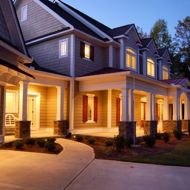 Early morning glow on 4 bed 4 bath almost 4,000 sq ft house plan 3645DK. Plan Link: http://bit.ly/3645dk #adhouseplans #architecturaldesigns #houseplan #porch #frontporch #columns #gables #countryhome #countryhouse #rockingchair #house #home #architect #architecture #design #construction