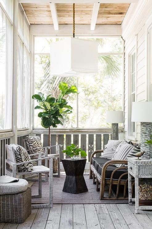 Beach Style Enclosed Porch Features A Rattan Sofa Lined