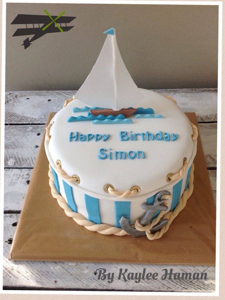 cake anchor and sailing ship blue and white stripes rope manly