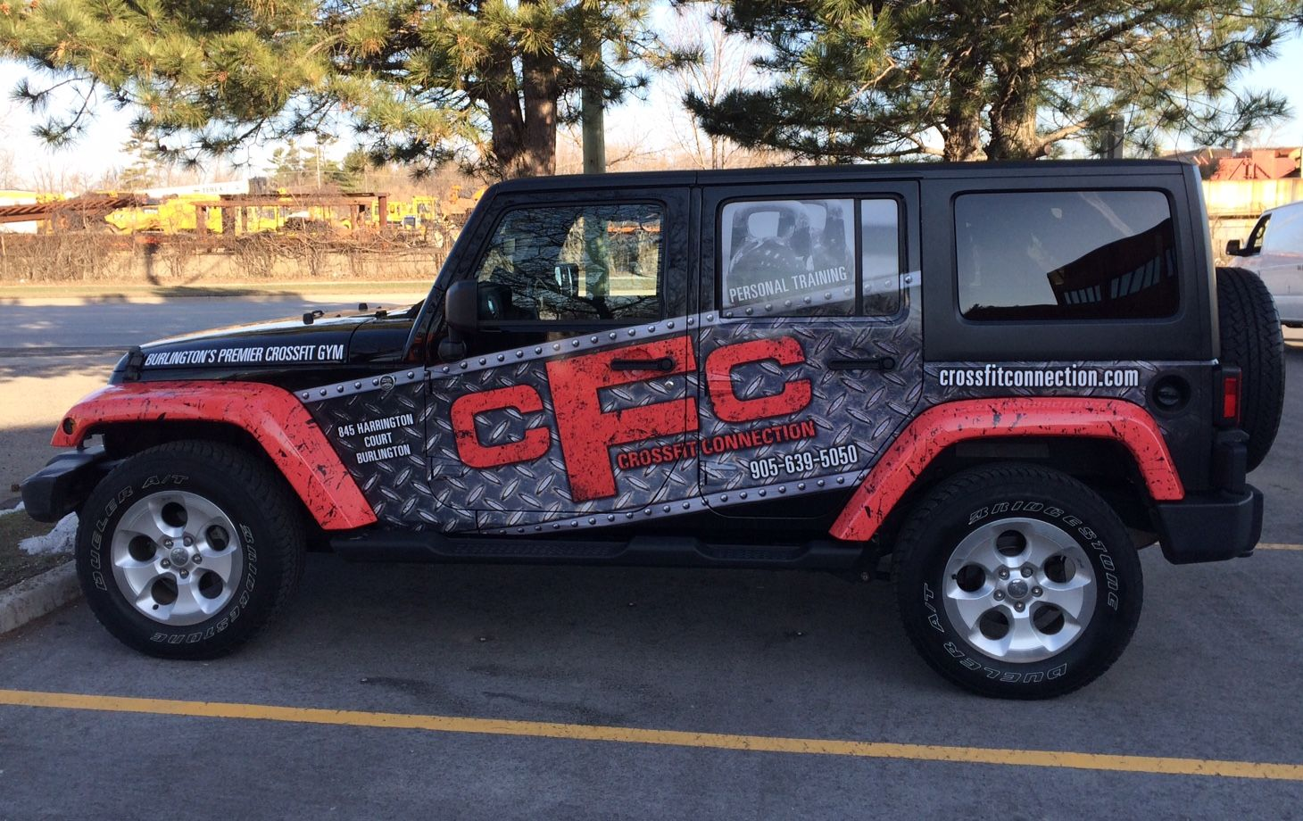 This Jeep Sahara 4 door partial wrap for Crossfit Connection completed by Speedpro Imaging Oakville. The owner wanted to extend his current branding from the gym to his vehicle. Impactful!