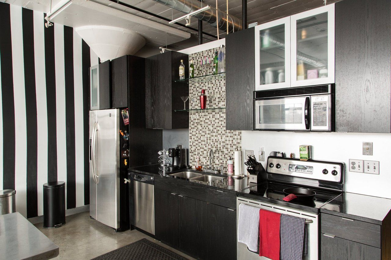 An Industrial Loft with a Vintage Vibe Home kitchens