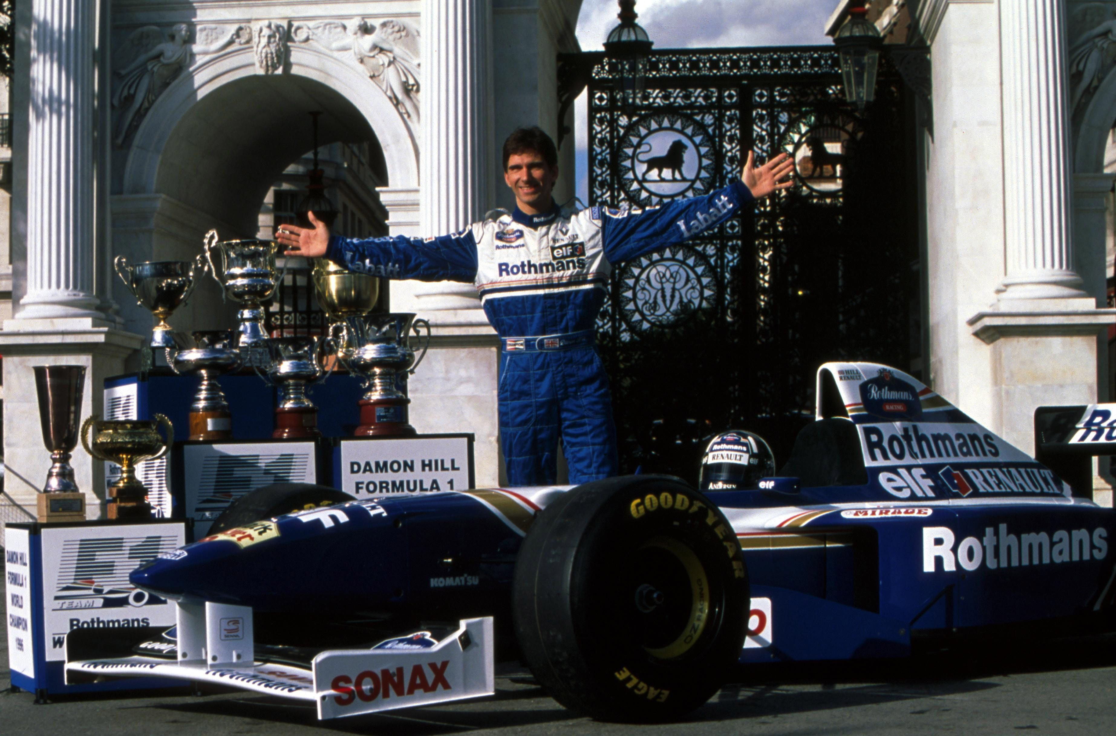1996 world champion damon hill with his trophies. Black Bedroom Furniture Sets. Home Design Ideas