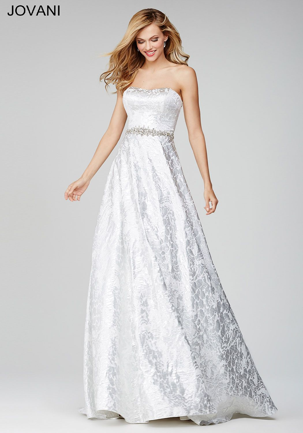 ebbea71b90f Floor length strapless white ball gown with a straight across neckline