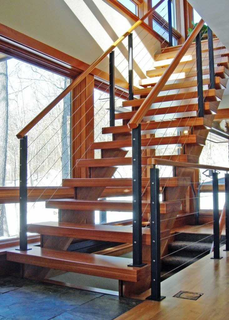 Wood Clad Stringer Railing With Black Steel Posts And Wood