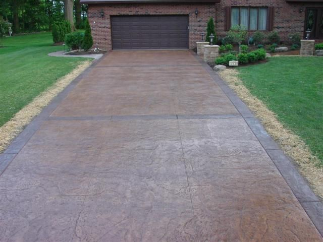 Old Granite Cleft Stone Stamped Concrete Driveway
