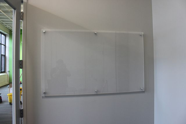 Frosted Glass Dry Erase Board On A White Wall Erase