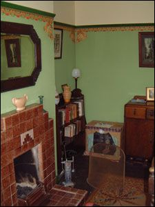 Sitting Room With Green Walls And Red Brickwork 1940s.