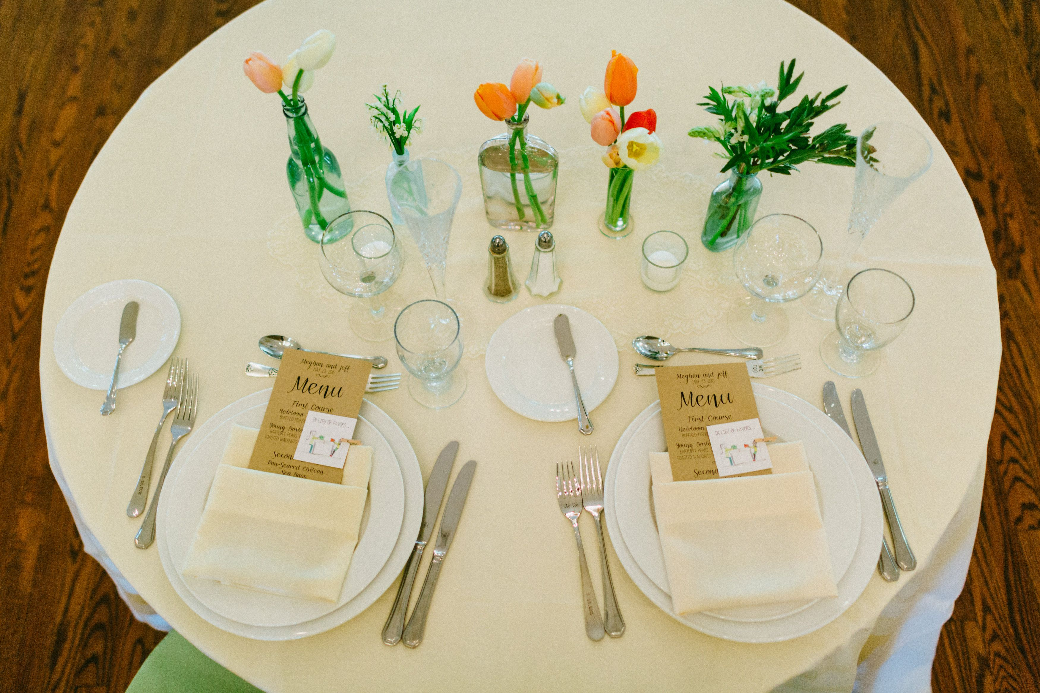 Late May wedding. Local tulips, lily of the valley, herbs. Photo Credit: Caroline Ghetes